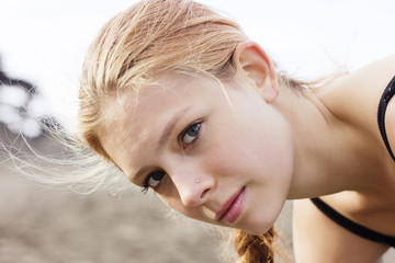 Close-up portrait of confident young woman