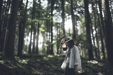 Low angle view of woman with eyes closed in forest