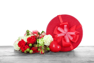 Gift box with flowers on white background