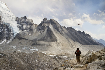 Rear view of man standing by Mt. Everest during winter
