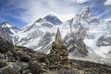Stone heap on snow covered Mt. Everest