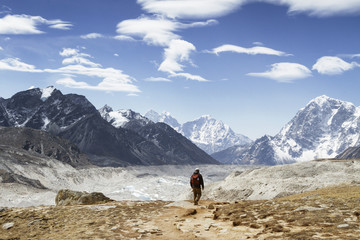 Rear view of man walking towards Mt. Everest during winter