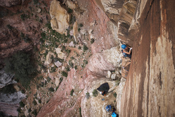 Female hiker climbing mountains at Red Rock Canyon National Conservation Area