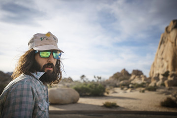 Portrait of bearded outdoorsman wearing sunglasses in Joshua Tree State Park