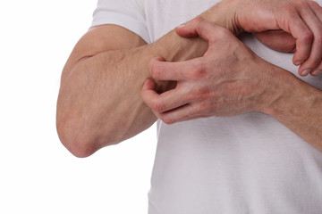 Man Scratching an itch on white background . Sensitive Skin, Allergic Reaction, Irritation