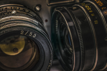Close up view of two lenses on old Russian analog film cameras with vintage look. There can be seen aperture ring, focusing ring, filter thread