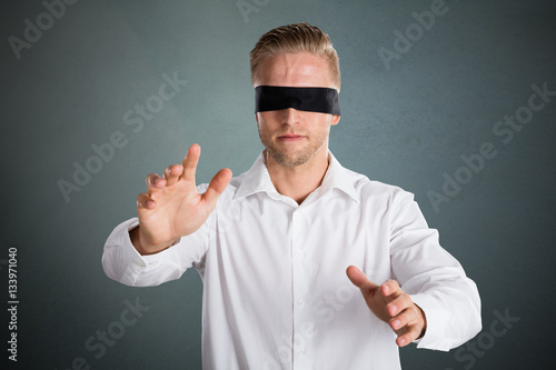 903be714b1d Young Blindfolded Businessman