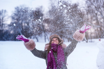Young Winter Girl Enjoying The Snow