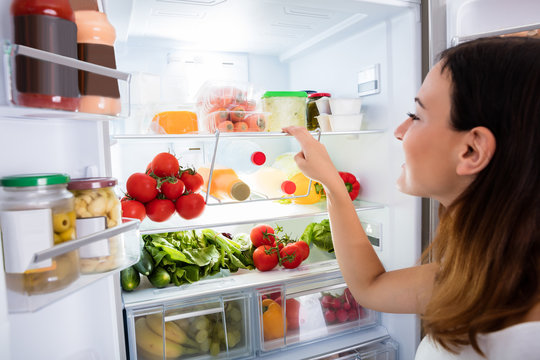 Woman Searching For Food In The Fridge