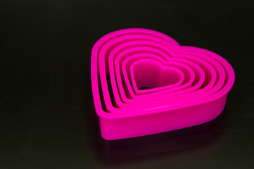 pink heart shaped on black background