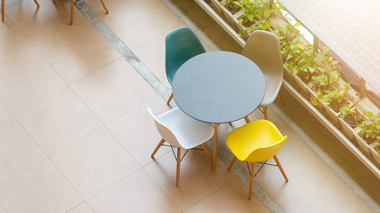 Top view of modern table and chairs