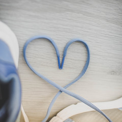 Love sign, Selective focus close up blue sport shoes on gray flo