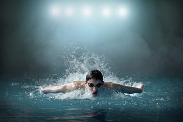 Swimmer man. Swimmings athlete competing distance in waterpool