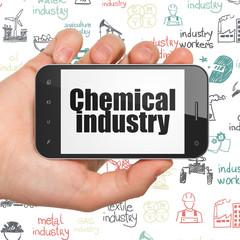 Industry concept: Hand Holding Smartphone with Chemical Industry on display