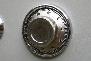 Combination lock on small home fire safe to protect documents and valuables from fire and burglary.