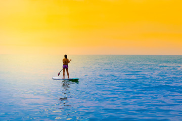 Woman is playing surf at sea