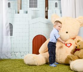 toddler Boy hugging big bear