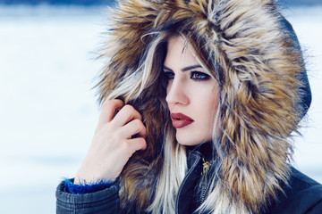 Portrait of a young beautiful woman on winter day