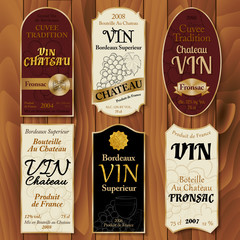 Set of vintage wine labels with hand-drawn details on wooden bac