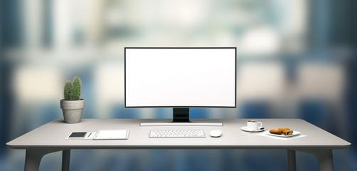 Postazione ufficio con computer e caffè