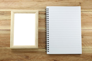 Wooden frame and empty notebook.