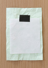 Note paper crumpled of empty and copy space on wooden background