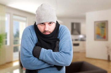 Male in winter clothes inside the house