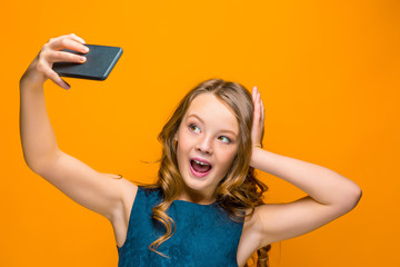The face of playful happy teen girl with phone