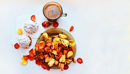 Day of valentina.Romantika.Vnimanie. Tasty dessert. Morning coffee with rose petals. Cakes, coffee, rose petals on white background, space for text heart made of rose petals