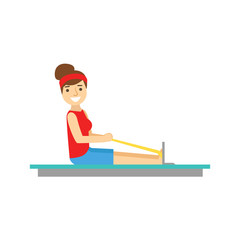 Woman Exercising On Rowing Simulator, Member Of The Fitness Club Working Out And Exercising In Trendy Sportswear