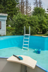 Pool equipment: a thermometer and a vacuum cleaner brush