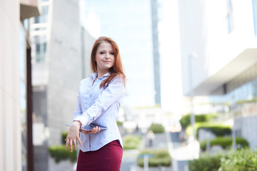 Young business woman on the modern city downtown background