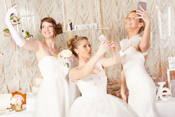 brides taking selfie and making funny grimaces