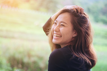 Asian woman smiling with perfect smile in the green nature Fotoväggar