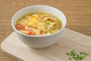 Delicious Thai Omelet Soup with Tomatoes, Onion and Scallion