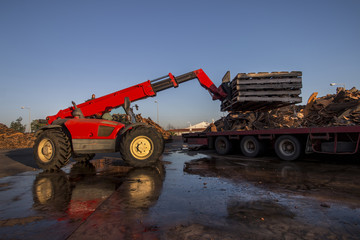 Vehicle maneuvering raw cork planks from heavy duty truck