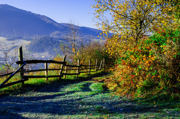 Autumn Landscape, wooden fence and blue mountains in the backgro