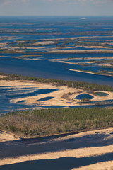 Flooded terrain near great river in spring, top view