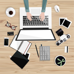 Desktop with isolated laptop, camera, notebooks, coffee, glasses, credit card, photos. Photographer's table. Top view. Wood background. Vector flat illustration. Freelance. Office work.