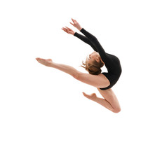 Printed kitchen splashbacks Gymnastics Young slim gymnast in gracefull jump studio shot