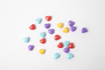 Miniature plastic hearts love on white background