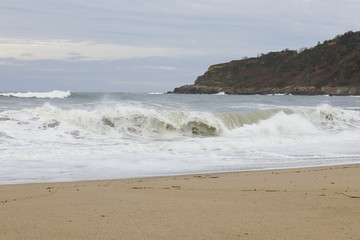 View of a big waves crashing at the shore.