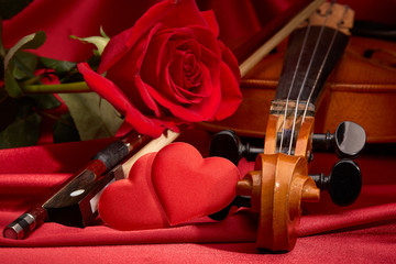 Violin, red rose and heart.