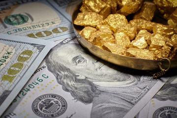 mound gold and dollar bills