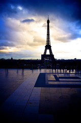 Color blue sky black and white photo of the Eiffel Tower of Paris