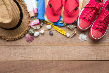 Summer holiday concept, accessories and travel items on wooden board, flat lay, top view background