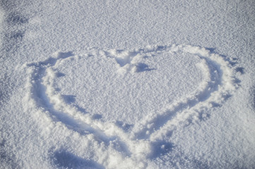 Symbol of heart on the background  fresh snow