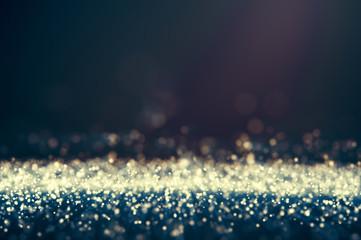 Glitter lights defocused background. Bokeh dark illustration