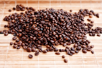 Fragrant coffee beans close-up on solar pleasant uniform light