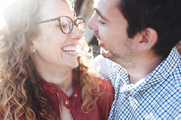 Close-up of smiling couple looking at each other